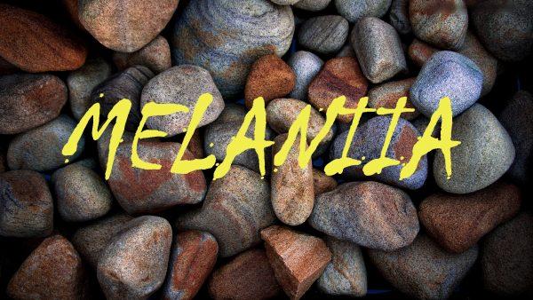 Надпись MELANIIA на фоне камней